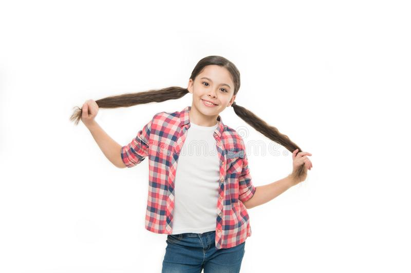 Healthy hair care habits. Kid happy smiling cheerful face with adorable hairstyle white background isolated. Strong hair royalty free stock photos