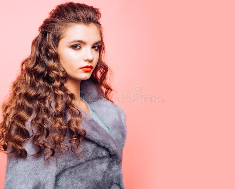 Healthy hair care habits. Teenage girl with stylish wavy hairstyle. Pretty girl with curly hairstyle. Young woman with. Long locks of hair. Hair styling in royalty free stock photography