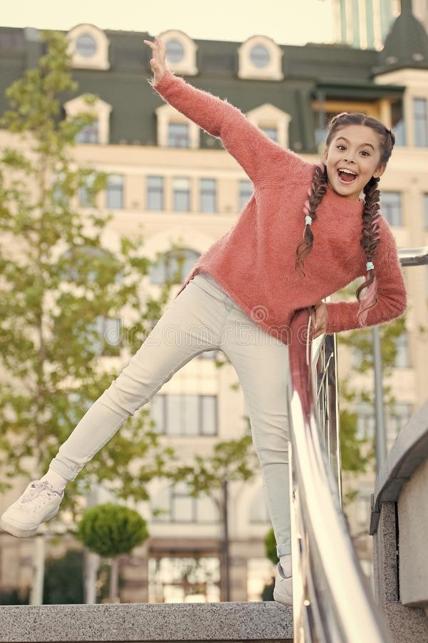 A healthy and happy life. Healthy little child smiling on urban background. Happy small girl enjoy healthy growth and stock image