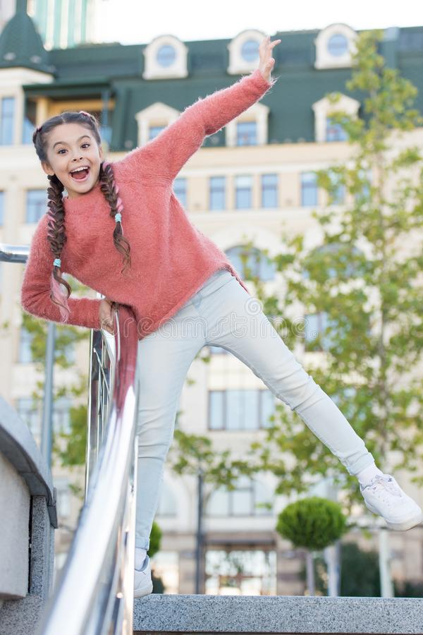 A healthy and happy life. Healthy little child smiling on urban background. Happy small girl enjoy healthy growth and royalty free stock images