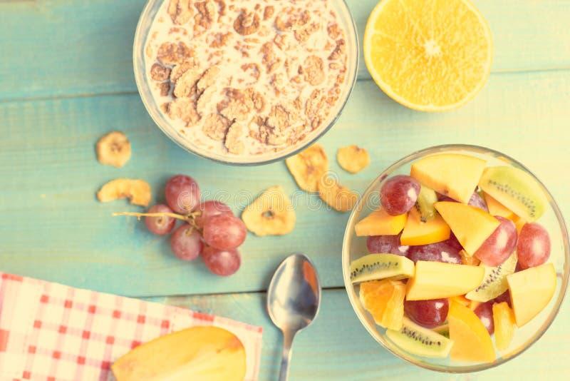 Useful breakfast from porridge and fruit stock image