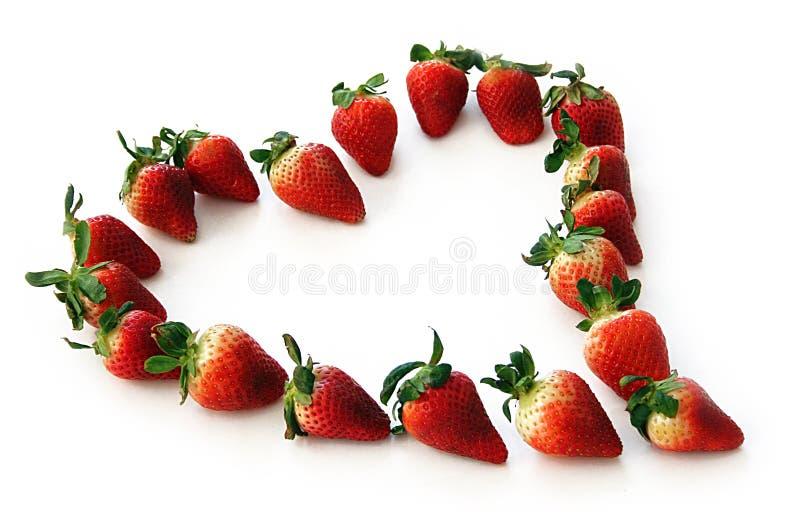 Healthy heart. Heart made of fresh farmer's market strawberries royalty free stock photography