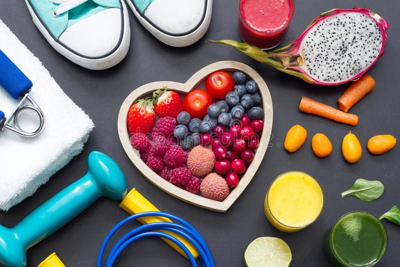 Healthy heart diet and sport gym equipment concept on blackboard royalty free stock photo
