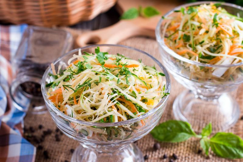 Healthy homemade carrot, celery and apple salad. Concept of veggies diet, vegan food, vitamin snack royalty free stock photo