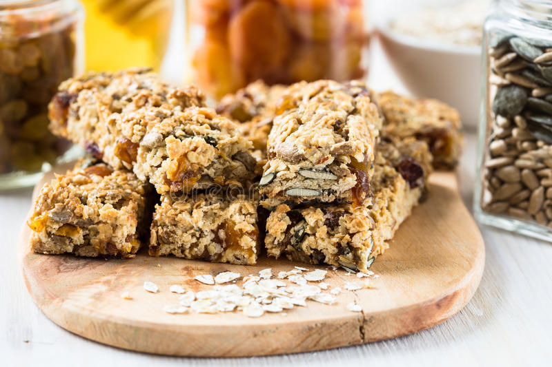 Healthy homemade granola bars and ingredients on background. Healthy homemade granola bars and various ingredients on background stock photos