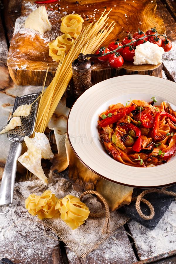 Healthy homemade mediterranean dish spaghetti with tomato sauce stock photo