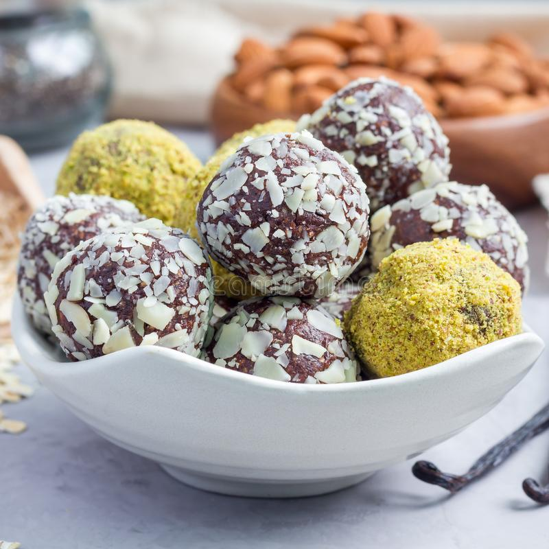 Healthy homemade paleo chocolate energy balls on plate, square royalty free stock image