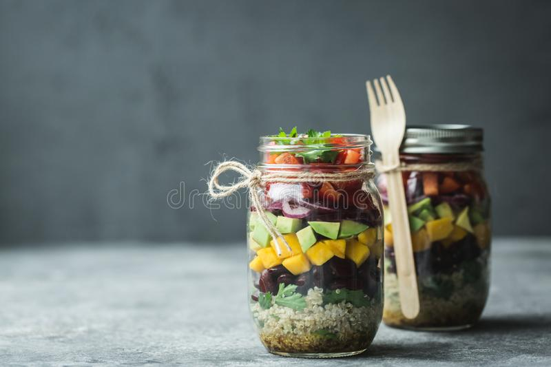 Healthy homemade salad in mason jar with quinoa and vegetables. Healthy food, clean eating, diet and detox. Copy space royalty free stock photos