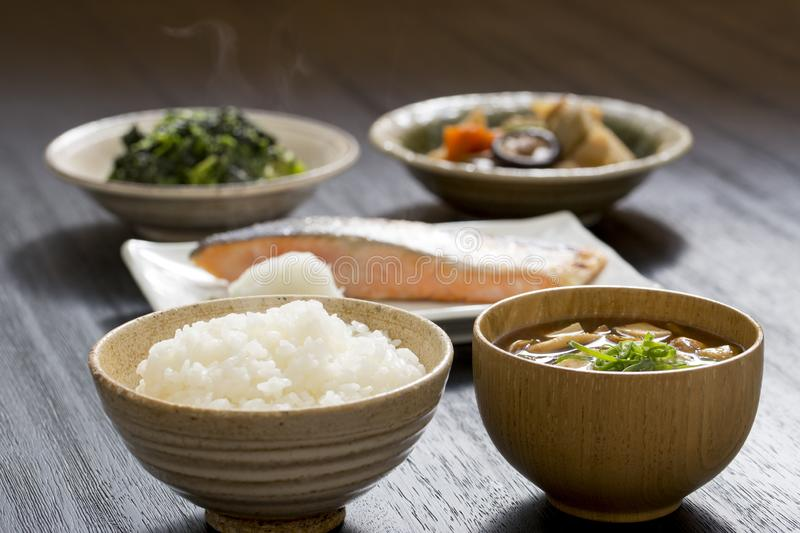 Healthy Japanese food. With lots of vegetables on black wooden table stock photography