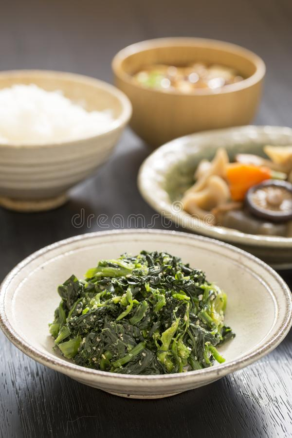 Healthy Japanese food. With lots of vegetables on black wooden table royalty free stock image