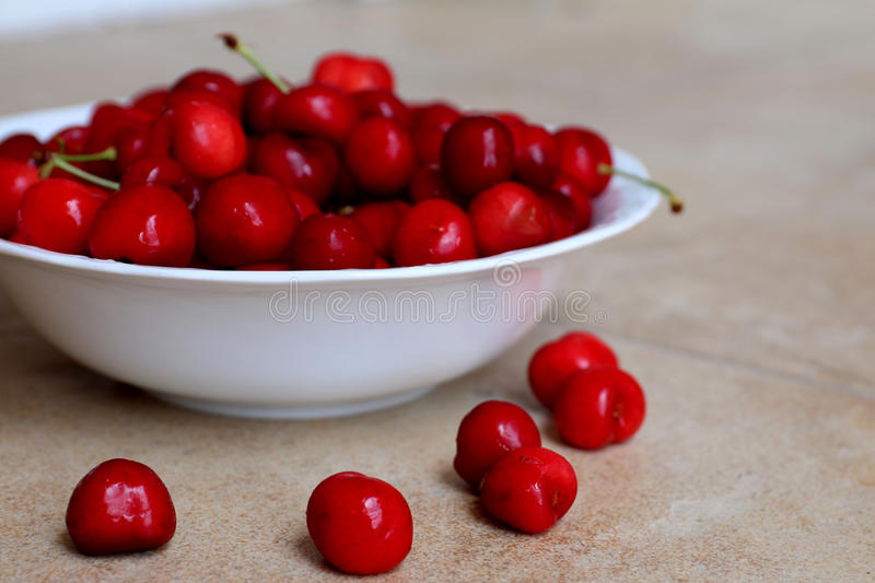 Healthy, juicy, fresh, organic cherries in fruit bowl close up. Cherries in background. stock image
