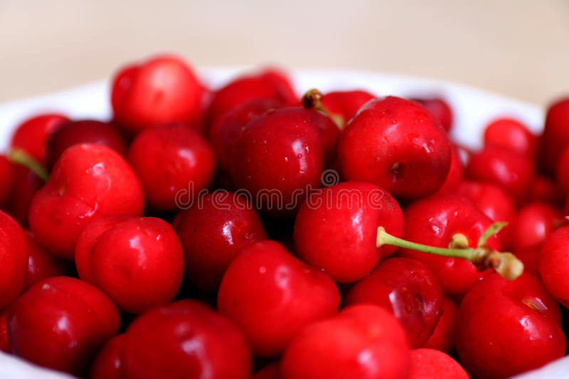 Healthy, juicy, fresh, organic cherries in fruit bowl close up. Cherries in background. stock photography