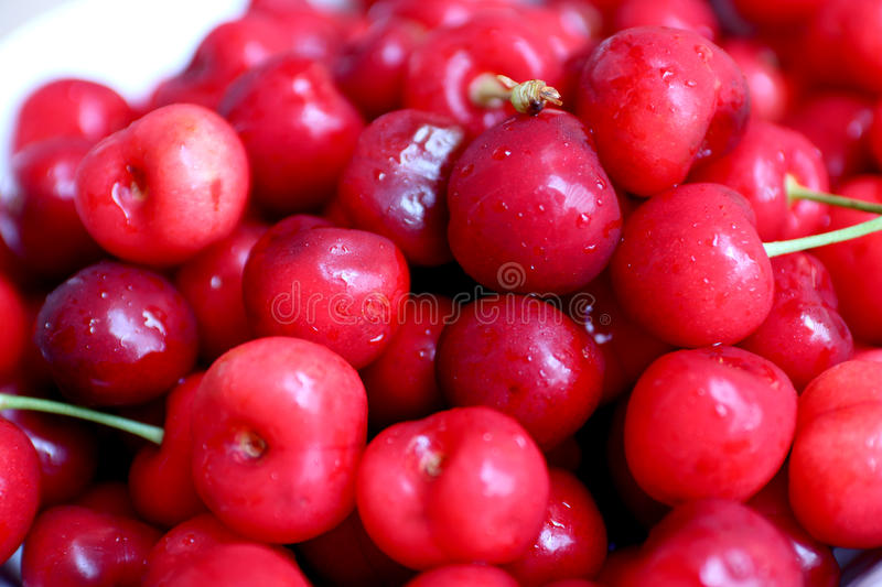Healthy, juicy, fresh, organic cherries in fruit bowl close up. Cherries in background. stock photos