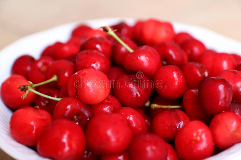 Healthy, juicy, fresh, organic cherries in fruit bowl close up. Cherries in background. royalty free stock photography