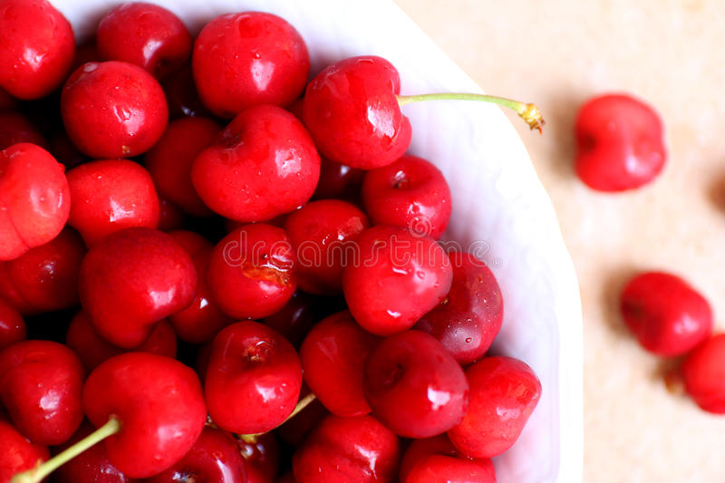 Healthy, juicy, fresh, organic cherries in fruit bowl close up. Cherries in background. royalty free stock photos