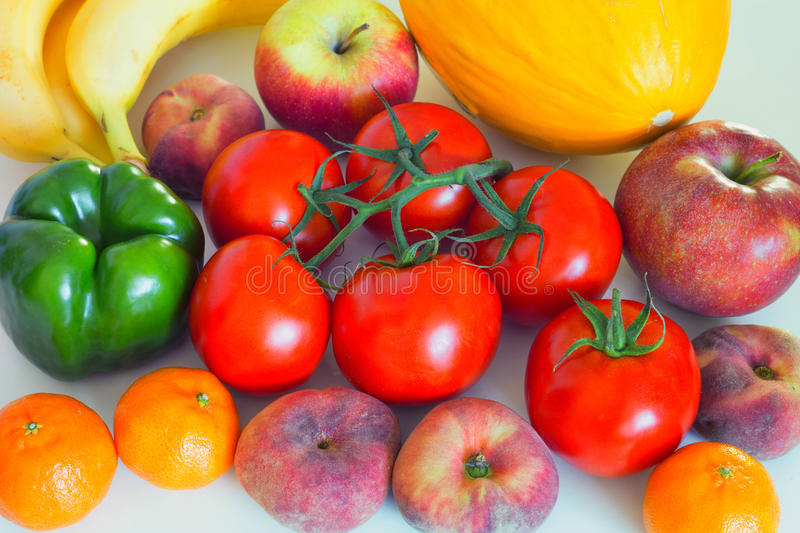 Healthy and juicy vegetables and fruits on the kithen table, an excellent ingredient in a vegetarian mea lor a side dish stock photo