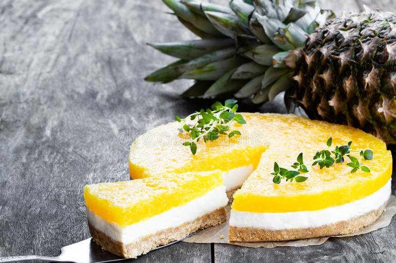 Healthy layered pineapple cheese cake on wooden table. Healthy  layered pineapple cheese cake on wooden table royalty free stock photography