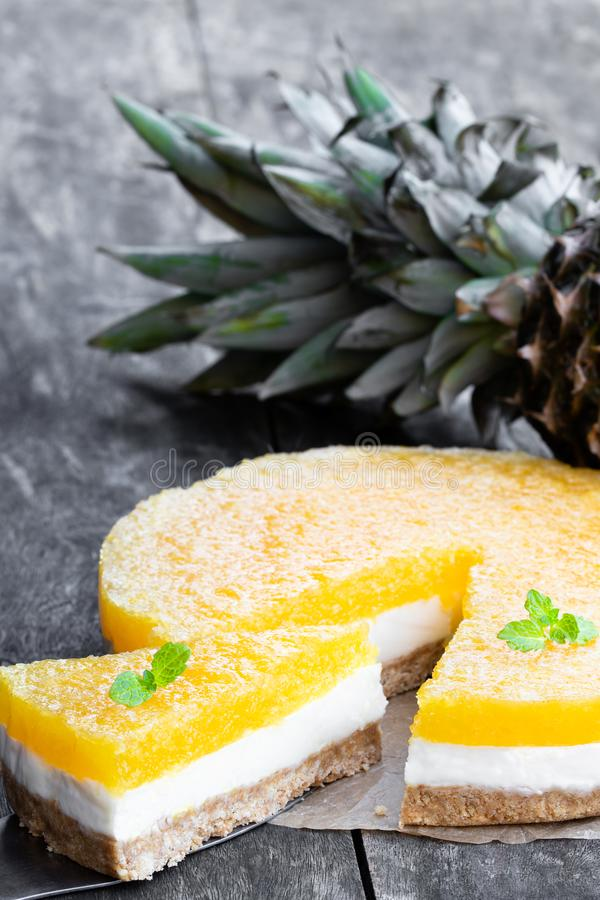 Healthy layered pineapple cheese cake on wooden table. Healthy  layered pineapple cheese cake on wooden table stock images