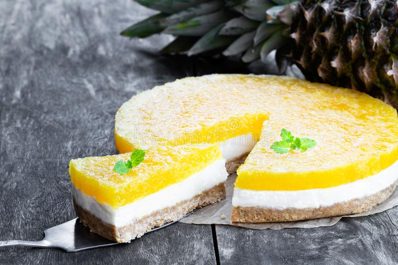 Healthy layered pineapple cheese cake on wooden table. Healthy  layered pineapple cheese cake on wooden table stock image