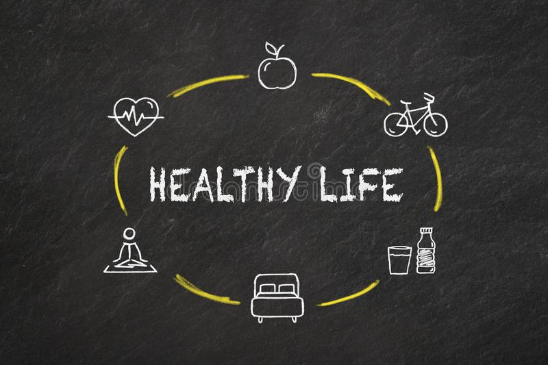 `Healthy life` text and icons on a blackboard. vector illustration