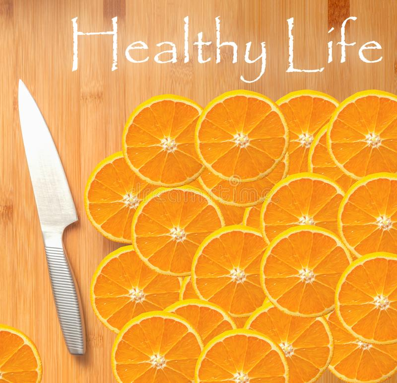 Healthy life concept - sliced oranges. On wooden table royalty free stock photography