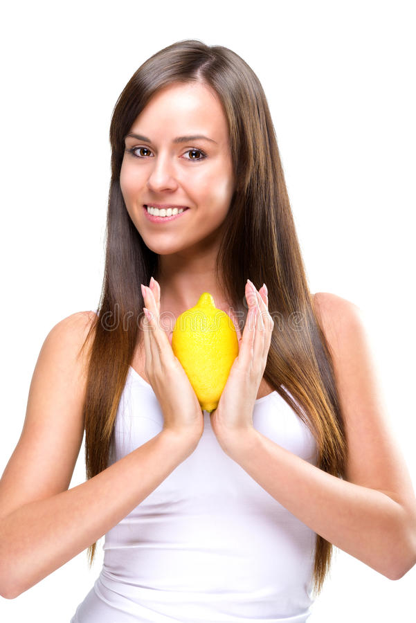 Healthy lifestyle - Beautiful pretty woman with lemon in hand imagem de stock