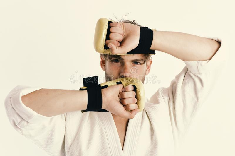 Healthy lifestyle and boxing concept. Man with hidden face and bristle on white background. MMA fighter with strong body practices martial arts. Guy poses in royalty free stock photo