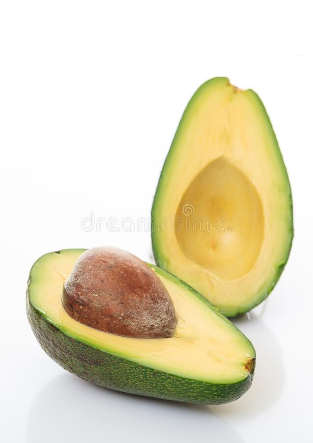 Healthy lifestyle concept. Avocado cut half isolated on white background stock images
