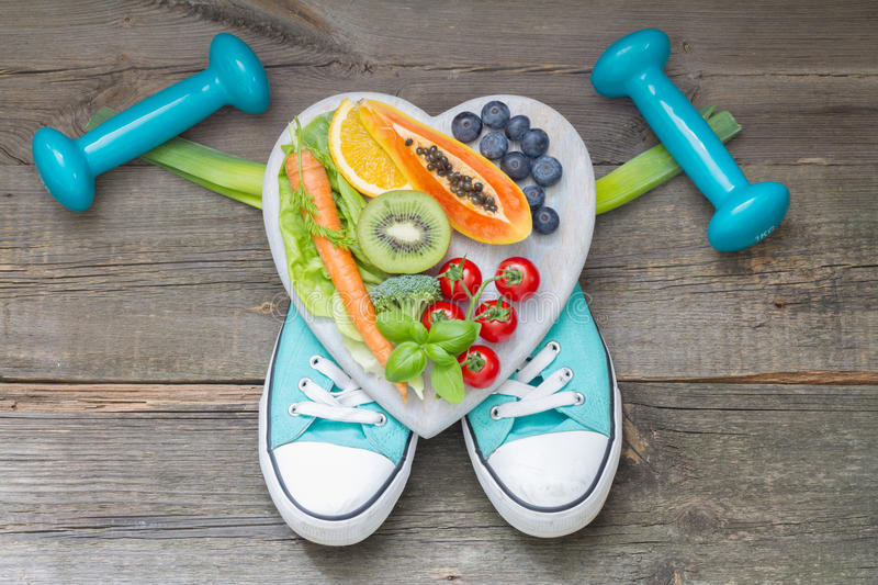 Healthy lifestyle concept with diet and fitness abstract on wooden boards royalty free stock images
