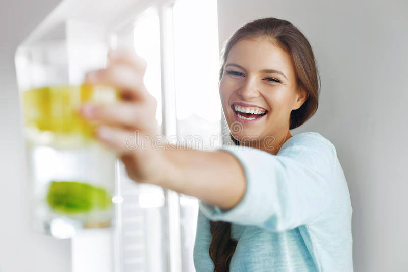 Healthy Lifestyle Concept, Diet And Fitness. Woman Drinking Water With Lemon , Lime And Mint royalty free stock images