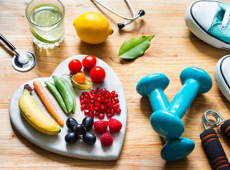 Healthy lifestyle concept with food in heart diet fitness sport and medicine concept. Closeup stock image