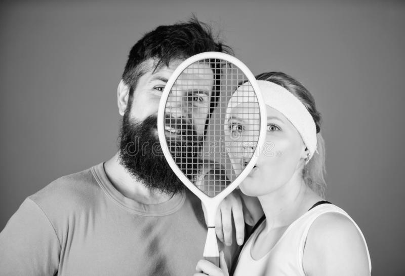 Healthy lifestyle concept. Man and woman couple in love with tennis racket sport equipment. Workout and fitness. Girl. Healthy lifestyle concept. Man and women royalty free stock images