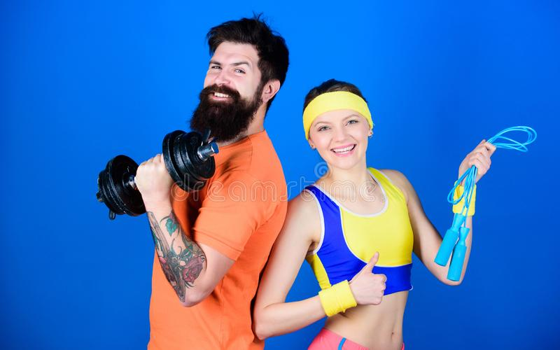 Healthy lifestyle concept. Man and woman exercising with dumbbell and jumping rope. Fitness exercises. Workout and royalty free stock images