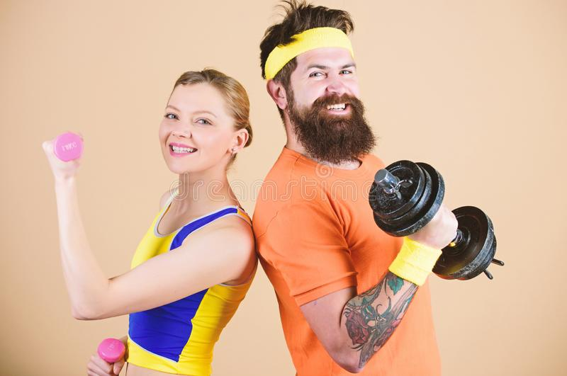 Healthy lifestyle concept. Man and woman exercising with dumbbells. Fitness exercises with dumbbells. Workout with. Healthy lifestyle concept. Man and women royalty free stock photo