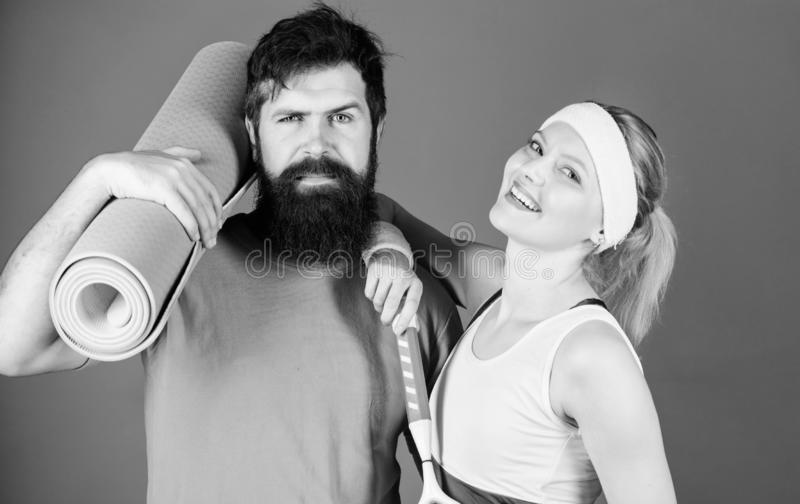 Healthy lifestyle concept. Man and woman couple in love with yoga mat and sport equipment. Fitness exercises. Workout. Healthy lifestyle concept. Md women couple royalty free stock photos