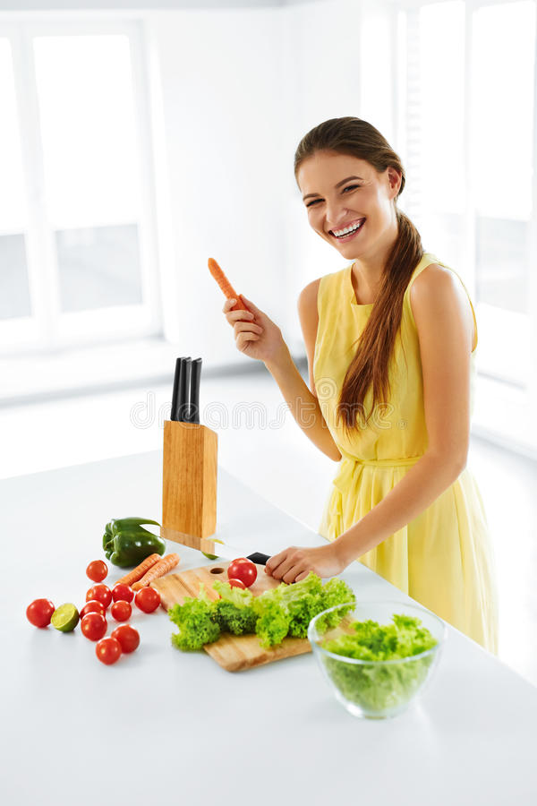 Healthy Lifestyle And Diet. Woman Preparing Salad. Healthy Food, Eating. Healthy Lifestyle And Diet. Portrait Of Happy Smiling Woman Preparing Fresh Organic stock image