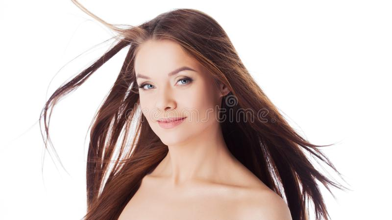 Healthy lifestyle and face care. Portrait of a young beautiful woman with with long hair, close-up royalty free stock photography
