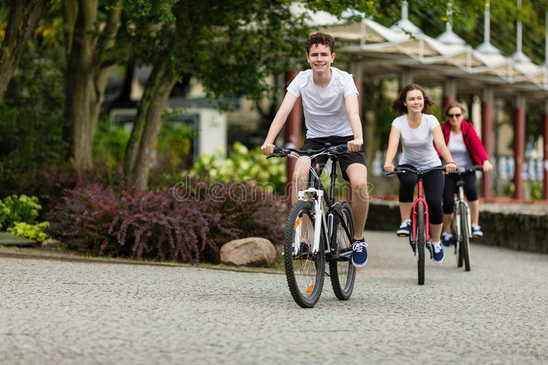 Healthy lifestyle - people riding bicycles in city park royalty free stock photos