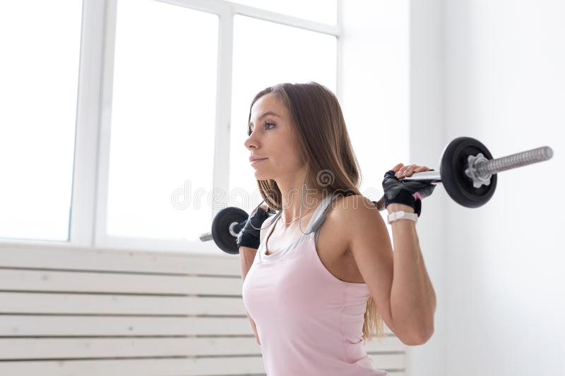 Healthy lifestyle, fitness, people and sport concept - Close up portrait of fit woman in pink shirt workout with body. Bar royalty free stock photography