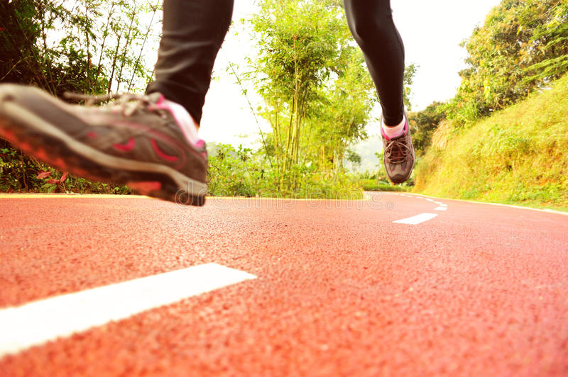 Healthy lifestyle fitness sports woman legs runnin. G at park trail stock image