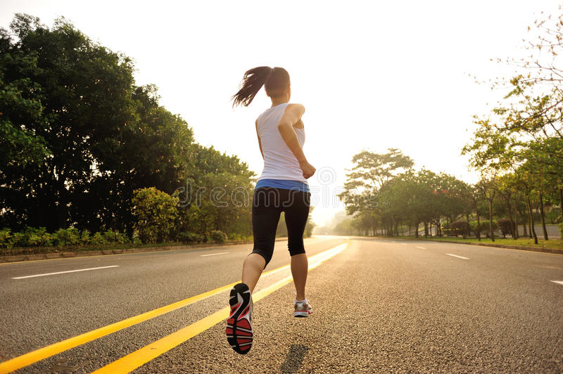 Healthy lifestyle fitness sports woman running. At road stock image