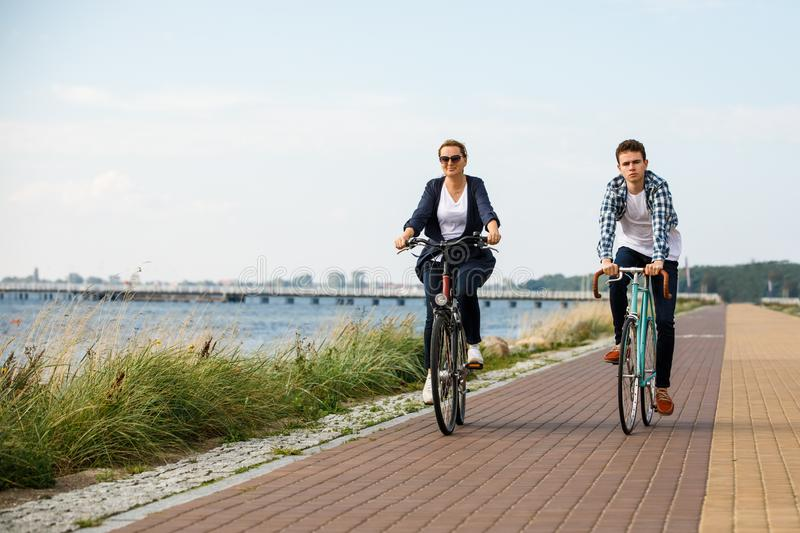 Healthy lifestyle - people riding bicycles. Healthy lifestyle - happy people riding bicycles royalty free stock image