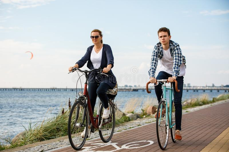 Healthy lifestyle - people riding bicycles. Healthy lifestyle - happy people riding bicycles royalty free stock photo