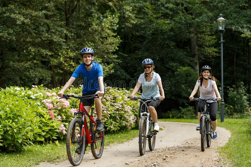 Healthy lifestyle - people riding bicycles. In city park royalty free stock photography