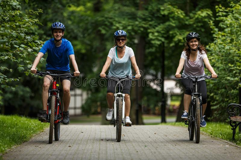 Healthy lifestyle - people riding bicycles. In city park royalty free stock images