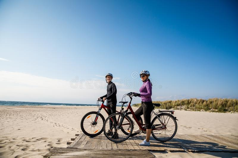 Healthy lifestyle - people riding bicycles. Healthy lifestyle - happy people riding bicycles stock photos