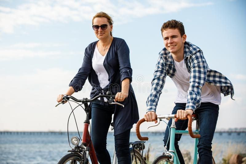 Healthy lifestyle - people riding bicycles. Healthy lifestyle - happy people riding bicycles stock photography