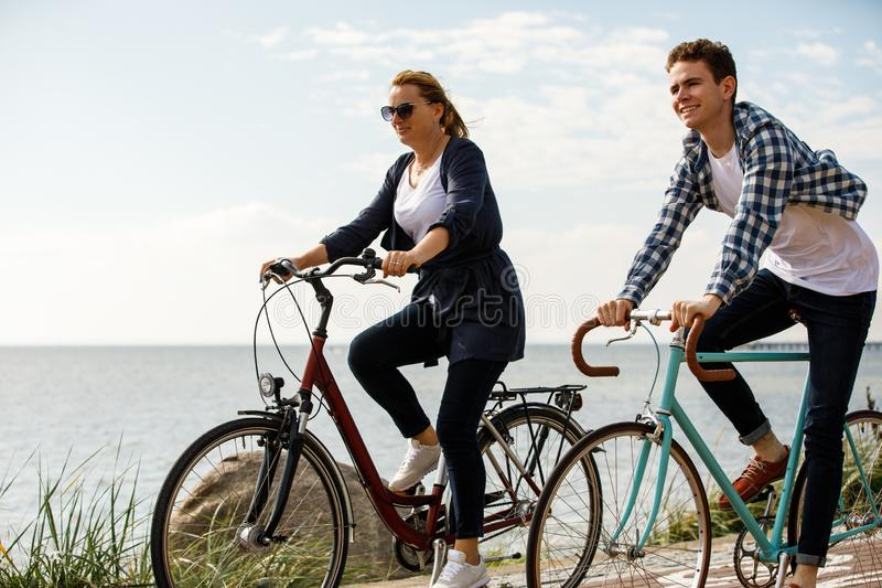 Healthy lifestyle - people riding bicycles. Healthy lifestyle - happy people riding bicycles stock image
