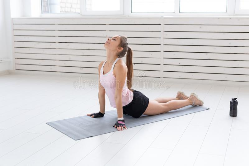 Healthy lifestyle, people and sport concept - Woman workout with stretching.  royalty free stock photo