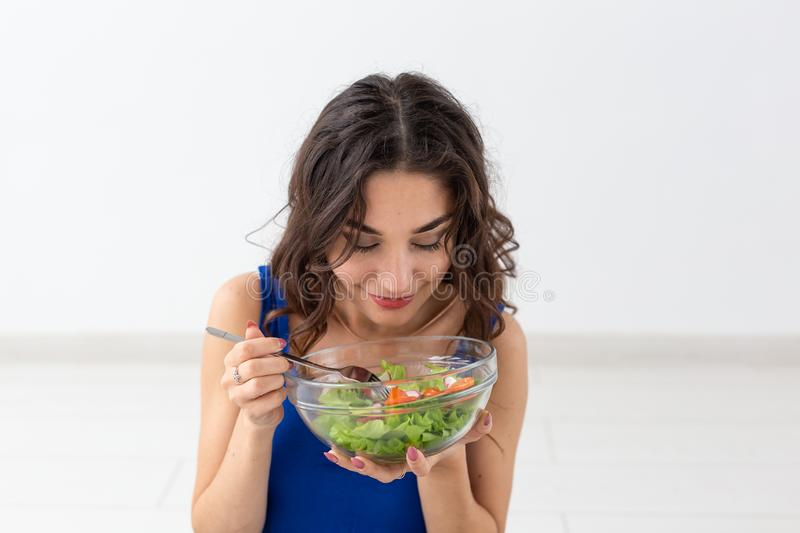 Healthy lifestyle, people and sport concept - Yoga woman with a bowl of vegetable salad.  royalty free stock photo